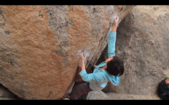 Grabbing the gritty pinch on Fly Boy Arete (V5)