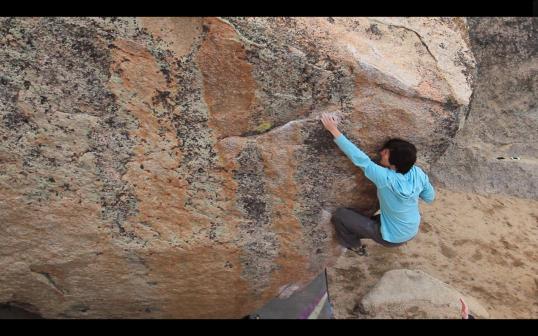 Vikki making the last big span on Fly Boy Arete (V5)