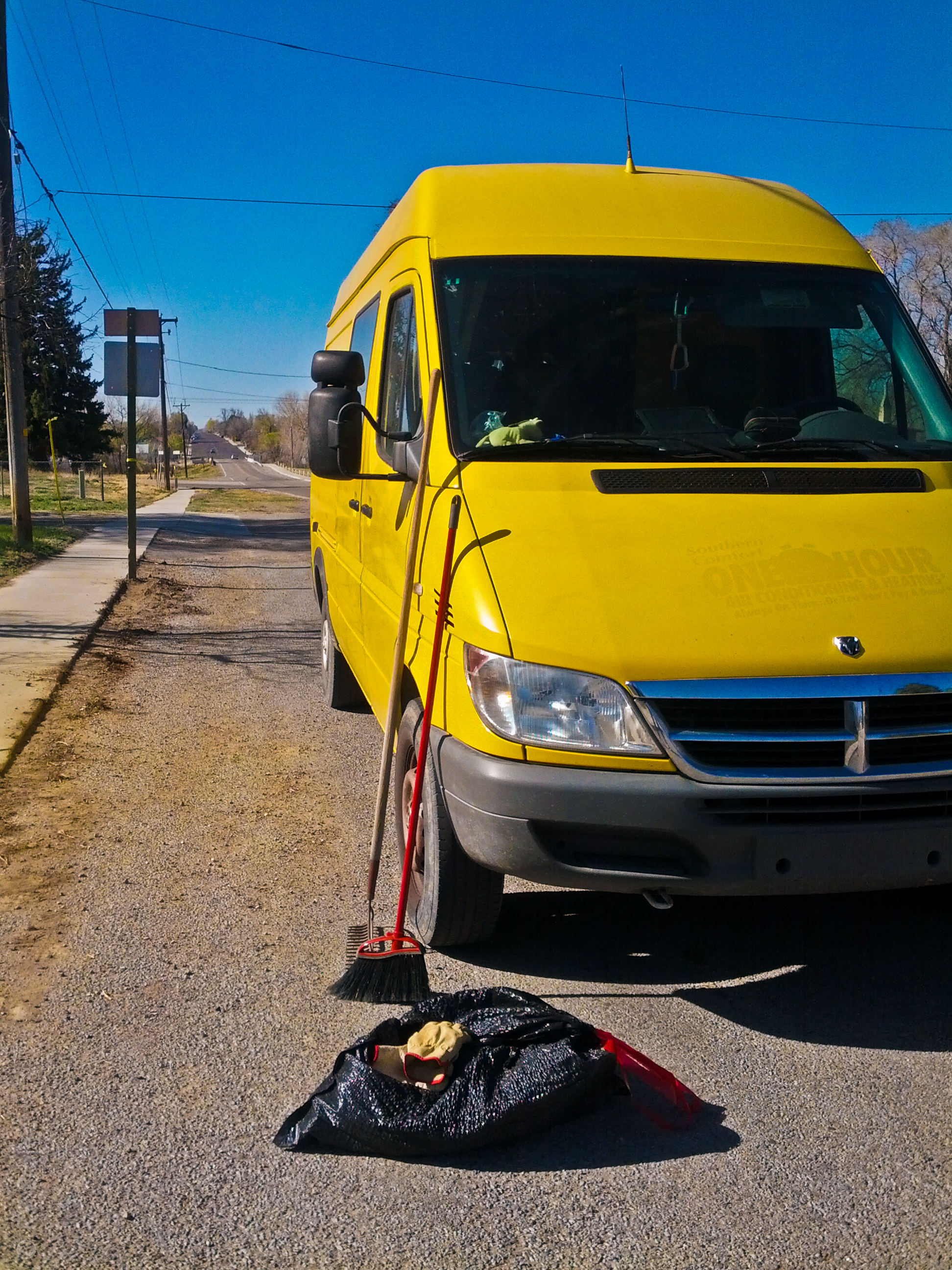 The Sprinter you can't miss, helping hold our clean-up tools.